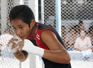 Thai prisoner Siriporn Taweesook warms up during a training session at the Women's Correctional Institution for Drug Addicts in Pathum Thani